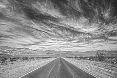 Black and white photo of a highway in Death Valley, USA. Stock Photo