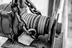 Black and white photo of industrial steel cable motorized winch Stock Photo