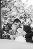 Black and white photo of just married couple. Bride and groom. Wedding dress. Wedding photo Royalty Free Stock Images
