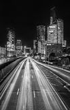 Black and White photo of La Defense Financial District at night with traffic lights. Paris, France Stock Photography