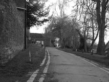 Black and white photo of lane. Black and white photo of a country side road Royalty Free Stock Image