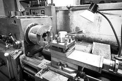 Black and white photo of Lathe machine tool royalty free stock image