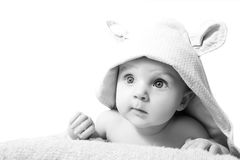Black and white photo of a little girl who, after  bath wearing Royalty Free Stock Photos