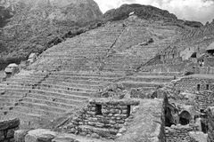 Black & White photo of Machu Picchu Terraces. A view back up to the entrance to Macchu Pichu from the Inca Trail. Terracing and stone work stretches as far as Stock Images