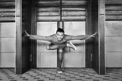 Black and white photo of man doing yoga royalty free stock photo