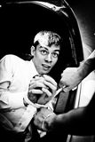 Black and white photo of man in trunk Royalty Free Stock Photo