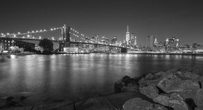 Black and white photo of Manhattan waterfront at night, NYC, USA Royalty Free Stock Photography