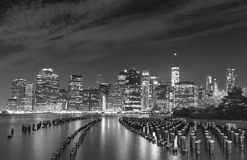 Black and white photo of Manhattan waterfront at night, NYC, USA Stock Image