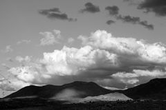 Black and white photo of monsoon clouds over the catalina mountains in Tucson, Arizona. Monsoon season clouds over the tucson mountains. Huge clouds. Catalina Royalty Free Stock Photos