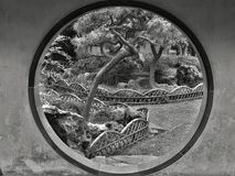 SUZHOU, JIANGSU PROVINCE CHINA, MAY 2015: Moon gate in the Humble administrator garden royalty free stock image