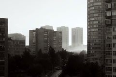 Black and white photo morning fog in gray industrial city Stock Photography