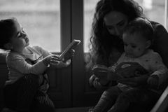 Black and White Photo of Mother and Children stock photos