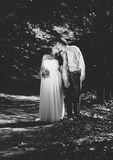 Black and white photo of newly married couple kissing Royalty Free Stock Image