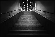 Black and white photo of night stairs with lanterns royalty free stock photos