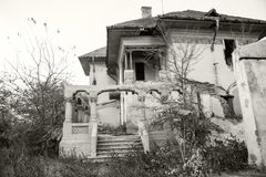 Black and white photo of an old, abandoned, ruined house Royalty Free Stock Photo
