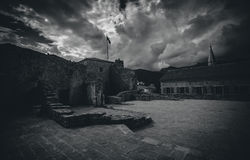 Black and white photo of old castle at cloudy day Stock Images