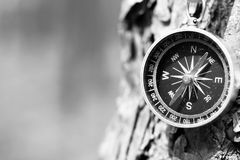 Black and white photo of an old compass in retro style / tourist compass closeup Royalty Free Stock Photos
