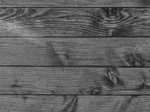 Black-white photo of an old wooden pine deck. Texture of wood.  royalty free stock image