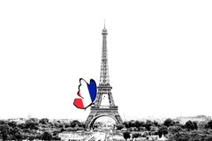 Black and white photo of Paris panorama with a view of the Eiffel Tower with butterfly around in the colors of the national flag. Of France. Isolated on white stock photo