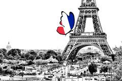 Black and white photo of Paris panorama with a view of the Eiffel Tower with butterfly in the colors of the national flag. Of France. Isolated on white royalty free illustration
