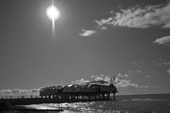 Black and white photo of the platform at sea. Near the shore Royalty Free Stock Photos