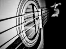 Black and white photo of playing guitar royalty free stock image