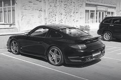 Kiev, Ukraine - June 8, 2017: Black and white photo. Porsche 911 Turbo in private parking lot stock image