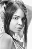 Black and white photo portrait of girl looks at camera Royalty Free Stock Image