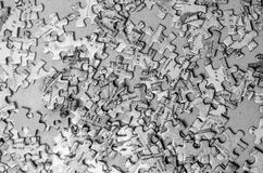 Puzzle pieces background texture. Black and white photo of Puzzle pieces background with shallow depth of field Royalty Free Stock Photos