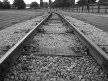A black and white photo of a railway track. Royalty Free Stock Image
