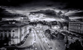 Black and White photo of the Revolution Square near Victoria Avenue in Bucharest, Romania. Traffic and historical buildings.Bucuresti Stock Images