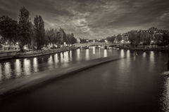 Black and White photo of river Seine in Paris, France at dusk. Stock Images