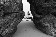 Black and white photo of rocky coastline of Atlantic ocean Stock Photos