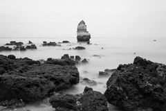Black and white photo of rocky coastline of Atlantic ocean Royalty Free Stock Images