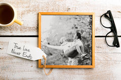 Black-and-white photo of senior couple in picture frame. Studio Royalty Free Stock Photos
