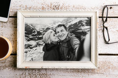 Black-and-white photo of senior couple in white picture frame. Stock Photos
