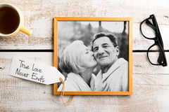 Black-and-white photo of seniors in picture frame. Studio shot. Royalty Free Stock Photos