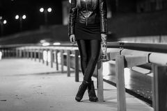 Black and white photo of sexy woman walking by the road with bot Royalty Free Stock Photo