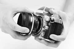 Black and white photo SLR camera in hands of photographer Royalty Free Stock Photos