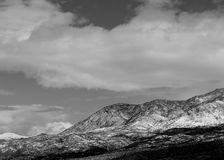 Black and white photo of the snow covered Catalina mountains in Tucson, Arizona. Royalty Free Stock Image