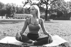 Black And White Photo Of Sports Woman Sitting On Rug In Park During Day Royalty