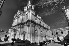 Black and white photo of the St. Peter & Paul Cathedral in the city of Mdina, in Malta, and visitors Stock Photo