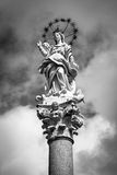 Black and white photo of the statue of Mary, mother of Christ, with starry halo in Lucca, Italy. The statue of Mary, mother of Christ, with starry halo in Lucca Royalty Free Stock Image