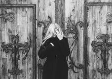 Woman Near The Door Stock Photography
