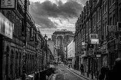 Black and White Photo of Street and Builldings With People Royalty Free Stock Photos