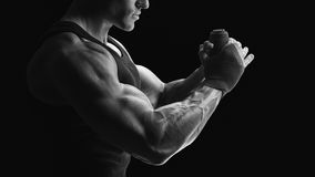 Black and white photo of strong hands and fist, ready for traini Stock Image