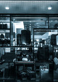 Black and white photo of suitcases and bags in a store window, i Royalty Free Stock Images