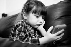 Black and white photo of thoughtful child girl Stock Images