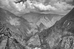 Black & White photo of valley view from Machu Picchu. A view back up to the entrance to Macchu Pichu from the Inca Trail. Terracing and stone work stretches as Royalty Free Stock Photo