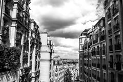 Black-white photo of view from Montmartre to summer Paris and beautiful cloudy sky. Paris, France Royalty Free Stock Image